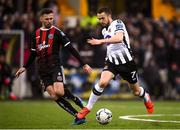 15 April 2019; Michael Duffy of Dundalk in action against Robbie McCourt of Bohemians during the SSE Airtricity League Premier Division match between Dundalk and Bohemians at Oriel Park in Dundalk, Louth. Photo by Stephen McCarthy/Sportsfile