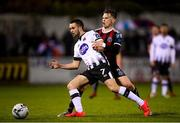 15 April 2019; Michael Duffy of Dundalk in action against Andy Lyons of Bohemians during the SSE Airtricity League Premier Division match between Dundalk and Bohemians at Oriel Park in Dundalk, Louth. Photo by Stephen McCarthy/Sportsfile