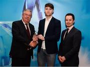 15 April 2019; Chris O'Leary of UCC who was named in the Electric Ireland HE GAA Rising Star Hurling Team of the Year 2019 is presented with his award by John Dwane of Electric Ireland, left, and Michael Hyland, Chairman, Higher Education GAA. The Electric Ireland HE GAA Rising Star Awards was hosted by Electric Ireland Sigerson and Fitzgibbon winners UCC where the overall Footballer and Hurler of the Year were announced as well as the overall Football and Hurling team of the Year for the Electric Ireland Sigerson, Fitzgibbon and Higher Education Championships. #FirstClassRivals Photo by Diarmuid Greene/Sportsfile
