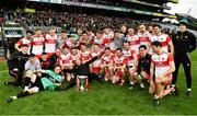 30 March 2019; The Derry squad celebrate with the cup after the Allianz Football League Division 4 Final between Derry and Leitrim at Croke Park in Dublin. Photo by Ray McManus/Sportsfile