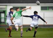 17 April 2019; Conor Duffy of South East offloads a pass under pressure from Tadgh Finley, left,  and Jack Foley of Metropolitan during the U18 Bank of Ireland Leinster Rugby Shane Horgan Cup - Final Round match between South East and Metropolitan at IT Carlow in Moanacurragh, Carlow. Photo by Harry Murphy/Sportsfile