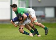 17 April 2019; John Ascough of Metropolitan is tackled by Paul Deeny of South East during the U18 Bank of Ireland Leinster Rugby Shane Horgan Cup - Final Round match between South East and Metropolitan at IT Carlow in Moanacurragh, Carlow. Photo by Harry Murphy/Sportsfile