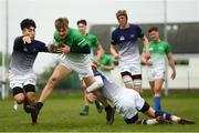 17 April 2019; Ben McGuinness of South East is tackled by Bao Tran, left, and Tadgh McKeever of Metropolitan during the U18 Bank of Ireland Leinster Rugby Shane Horgan Cup - Final Round match between South East and Metropolitan at IT Carlow in Moanacurragh, Carlow. Photo by Harry Murphy/Sportsfile