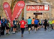 18 April 2019; Competitors run to the finishing line during the Kia Race Series Streets of Kilkenny 5k in Kilkenny City.  Photo by Harry Murphy/Sportsfile
