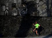 18 April 2019; A competitior warms up prior to the Kia Race Series Streets of Kilkenny 5k in Kilkenny City.  Photo by Harry Murphy/Sportsfile