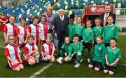 19 April 2019; The President of Ireland Michael D Higgins and his wife Sabina with the President of Irish Football Association David Martin, right, and players from Cliftonville FC and Linfield FC girls under 9 teams during his visit to the Irish Football Association Headquarters at the National Football Stadium in Windsor Park, Belfast. Photo by Oliver McVeigh/Sportsfile