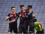 19 April 2019; Dinny Corcoran of Bohemians, centre, is congratulated by team-mates Darragh Leahy, left, and Daniel Mandroiu after scoring his side's first goal during the SSE Airtricity League Premier Division match between Bohemians and UCD at Dalymount Park in Dublin. Photo by Seb Daly/Sportsfile