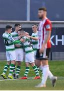 19 April 2019; Aaron Greene, second from left, is congratulated by his Shamrock Rovers team-mates, from left, Dylan Watts, Jack Byrne and Aaron McEneff after scoring his side's first goal during the SSE Airtricity League Premier Division match between Derry City and Shamrock Rovers at the Ryan McBride Brandywell Stadium in Derry. Photo by Stephen McCarthy/Sportsfile