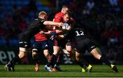 20 April 2019; Chris Farrell of Munster is tackled by Jackson Wray and Brad Barritt of Saracens during the Heineken Champions Cup Semi-Final match between Saracens and Munster at the Ricoh Arena in Coventry, England. Photo by Brendan Moran/Sportsfile