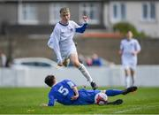 21 April 2019; John Kavanagh of Waterford is tackled by Darren Collins of Limerick during the FAI Youth Interleague Cup Final between Limerick and Waterford at Jackman Park in Limerick. Photo by Harry Murphy/Sportsfile