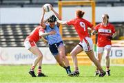 21 April 2019; Niamh McEvoy of Dublin gets away from Cork players, from left, Áine O'Sullivan, Niamh Cotter, and Ashling Hutchings during the Lidl NFL Division 1 semi-final match between Cork and Dublin at the Nowlan Park in Kilkenny. Photo by Piaras Ó Mídheach/Sportsfile
