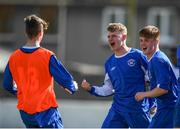21 April 2019; Ewan O'Brian of Limerick, centre, celebrates with AJ Molonet, left, and Jamie Greeves, right following the FAI Youth Interleague Cup Final between Limerick and Waterford at Jackman Park in Limerick. Photo by Harry Murphy/Sportsfile