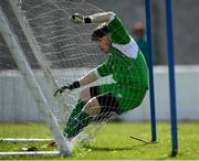 21 April 2019; Kyle Gahan of Waterford falls into his own net during the FAI Youth Interleague Cup Final between Limerick and Waterford at Jackman Park in Limerick. Photo by Harry Murphy/Sportsfile