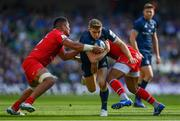 21 April 2019; Garry Ringrose of Leinster is tackled by Selevasio Tolofua, left, and Guillaume Marchand of Toulouse during the Heineken Champions Cup Semi-Final match between Leinster and Toulouse at the Aviva Stadium in Dublin. Photo by Ramsey Cardy/Sportsfile