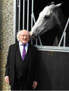 22 April 2019; President of Ireland Michael D. Higgins meets Whisper In The Breeze, a horse trained by Jessica Harrington, during the Fairyhouse Easter Festival - Irish Grand National day at Fairyhouse Racecourse in Ratoath, Meath. Photo by David Fitzgerald/Sportsfile