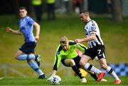 22 April 2019; Michael Duffy of Dundalk rounds goalkeeper  Conor Kearns of UCD on his way to scoring his side's second goal during the SSE Airtricity League Premier Division match between UCD and Dundalk at the UCD Bowl, Belfield in Dublin. Photo by Harry Murphy/Sportsfile