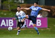 22 April 2019; Josh Collins of UCD in action against Patrick Hoban of Dundalk during the SSE Airtricity League Premier Division match between UCD and Dundalk at the UCD Bowl, Belfield in Dublin. Photo by Harry Murphy/Sportsfile