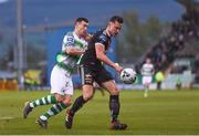 23 April 2019; Rob Cornwall of Bohemians in action against Aaron Greene of Shamrock Rovers during the SSE Airtricity League Premier Division match between Shamrock Rovers at Bohemians at Tallaght Stadium in Dublin. Photo by Eóin Noonan/Sportsfile