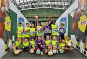 24 April 2019; Republic of Ireland mens national team manager Mick McCarthy, and Republic of Ireland Womens national team manager Colin Bell were on hand at the Aviva Stadium today to launch the 2019 SportsDirect.com FAI Summer Soccer Schools programme. The SportsDirect.com Summer Soccer Schools programme is the FAI's largest grass roots programme and one of the most important as it encourages children's involvement in sport, in a fun and friendly environment. Camps begin on July 1st and run right through to August 23rd, and are priced at €70. Pictured at the launch are Republic of Ireland mens national team manager Mick McCarthy, and Republic of Ireland womens national team manager Colin Bell, with young participants from across the country, at the Aviva Stadium in Dublin. Photo by Seb Daly/Sportsfile