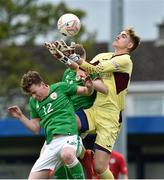 25 April 2019; Eric Green of Wales in action against Jack Doherty, left, and Ross Tierney of Republic of Ireland during the SAFIB Centenary Shield Under 18 Boys' International match between Republic of Ireland and Wales at Home Farm FC in Whitehall, Dublin. Photo by Matt Browne/Sportsfile