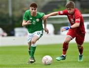 25 April 2019; Matthew O'Reilly of Republic of Ireland in action against Jake Hampson of Wales during the SAFIB Centenary Shield Under 18 Boys' International match between Republic of Ireland and Wales at Home Farm FC in Whitehall, Dublin. Photo by Matt Browne/Sportsfile