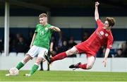 25 April 2019; Ross Tierney of Republic of Ireland in action against Toby Vickery of Wales during the SAFIB Centenary Shield Under 18 Boys' International match between Republic of Ireland and Wales at Home Farm FC in Whitehall, Dublin. Photo by Matt Browne/Sportsfile