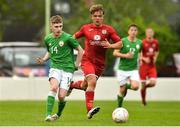 25 April 2019; Ross Tierney of Republic of Ireland in action against Dylan Rhys Jones of Wales during the SAFIB Centenary Shield Under 18 Boys' International match between Republic of Ireland and Wales at Home Farm FC in Whitehall, Dublin. Photo by Matt Browne/Sportsfile