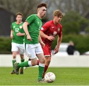 25 April 2019; Matthew O'Reilly of Republic of Ireland in action against Dylan Rhys Jones of Wales during the SAFIB Centenary Shield Under 18 Boys' International match between Republic of Ireland and Wales at Home Farm FC in Whitehall, Dublin. Photo by Matt Browne/Sportsfile