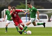 25 April 2019; Brandon Bermingham of Republic of Ireland in action against Jake Hampson of Wales during the SAFIB Centenary Shield Under 18 Boys' International match between Republic of Ireland and Wales at Home Farm FC in Whitehall, Dublin. Photo by Matt Browne/Sportsfile