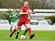 25 April 2019; Lee Jenkins of Wales in action against Brandon Bermingham of Republic of Ireland during the SAFIB Centenary Shield Under 18 Boys' International match between Republic of Ireland and Wales at Home Farm FC in Whitehall, Dublin. Photo by Matt Browne/Sportsfile