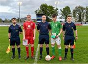 25 April 2019; Referee Mark Houilan with Wales captain Lee Jenkins and Republic of Ireland captain Josh Honohan before the SAFIB Centenary Shield Under 18 Boys' International match between Republic of Ireland and Wales at Home Farm FC in Whitehall, Dublin. Photo by Matt Browne/Sportsfile