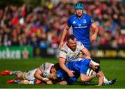 27 April 2019; Fergus McFadden of Leinster is tackled by Andy Warrick and Ian Nagle of Ulster during the Guinness PRO14 Round 21 match between Ulster and Leinster at the Kingspan Stadium in Belfast. Photo by Ramsey Cardy/Sportsfile