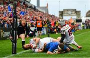 27 April 2019; Fergus McFadden of Leinster scores his side's second try despite the tackle of Darren Cave, left, and Michael Lowry of Ulster during the Guinness PRO14 Round 21 match between Ulster and Leinster at the Kingspan Stadium in Belfast. Photo by Ramsey Cardy/Sportsfile