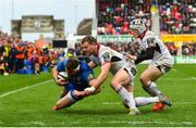 27 April 2019; Fergus McFadden of Leinster dives over to score his side's second try despite the tackle of Darren Cave, left, and Michael Lowry of Ulster during the Guinness PRO14 Round 21 match between Ulster and Leinster at the Kingspan Stadium in Belfast. Photo by Ramsey Cardy/Sportsfile