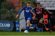26 April 2019; Ali Reghba of Bohemians in action against Jonathan Lunney of Waterford during the SSE Airtricity League Premier Division match between Bohemians and Waterford at Dalymount Park in Dublin. Photo by Sam Barnes/Sportsfile