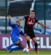 26 April 2019; Ali Reghba of Bohemians in action against  Aaron Simpson of Waterford during the SSE Airtricity League Premier Division match between Bohemians and Waterford at Dalymount Park in Dublin. Photo by Sam Barnes/Sportsfile