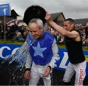 1 May 2019; Ruby Walsh is soaked by fellow jockey Davy Russell after he announced his retirement after he rode Kemboy to win The Coral Punchestown Gold Cup during the Punchestown Festival Gold Cup Day at Punchestown Racecourse in Naas, Kildare. Photo by David Fitzgerald/Sportsfile