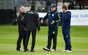 3 May 2019; Ireland captian William Porterfield, centre, and England captain Eoin Morgan in conversation with umpires Kumar Dharmasena and Paul Reynolds, during a pitch inspection prior to the One Day International between Ireland and England at Malahide Cricket Ground in Dublin. Photo by Sam Barnes/Sportsfile
