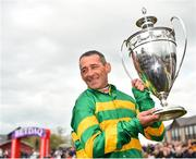3 May 2019; Jockey Davy Russell celebrates with the trophy after winning the BETDAQ Punchestown Champion Hurdle on Buveur D'air at Punchestown Racecourse in Naas, Kildare. Photo by Seb Daly/Sportsfile