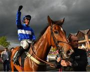 3 May 2019; Jockey Robbie Power celebrates as he enters the parade ring after winning the Alanna Homes Champion Novice Hurdle on Reserve Tank at Punchestown Racecourse in Naas, Kildare. Photo by Seb Daly/Sportsfile
