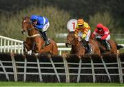 3 May 2019; Reserve Tank, with Robbie Power up, left, jumps the last, ahead of Sams Profile, with Davy Russell up, on their way to winning the Alanna Homes Champion Novice Hurdle at Punchestown Racecourse in Naas, Kildare. Photo by Seb Daly/Sportsfile