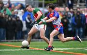 5 May 2019; Evan Regan of Mayo scores his side's first goal as Michael Creegan of New York closes in during the Connacht GAA Football Senior Championship Quarter-Final match between New York and Mayo at Gaelic Park in New York, USA. Photo by Piaras Ó Mídheach/Sportsfile