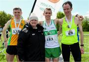 4 May 2019; Winner of the AAI Men's National 5k Championship Kieran Kelly of Raheny Shamrock A.C in Dublin with silver medallist Conor Duffy of Glaslough Harriers A.C. Monaghan, left, and bronze medallist Peter Arthur of Liffey Valley A.C. in Dublin, right, and Athletics Ireland President Georgina Drumm after the Irish Runner 5k in conjunction with the AAI National 5k Championships, Phoenix Park in Dublin. Photo by Brendan Moran/Sportsfile