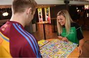 7 May 2019; Tipperary hurler Noel McGrath and Kilkenny camogie player Grace Walsh play the new Cúl Heroes Trading Card game 'Steps Shoot Tackle' during the Cúl Heroes Trading Cards 2019 Collection Launch at Croke Park in Dublin. Photo by David Fitzgerald/Sportsfile