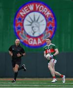 5 May 2019; Paddy Durcan of Mayo goes on the attack as referee Conor Lane looks on during the Connacht GAA Football Senior Championship Quarter-Final match between New York and Mayo at Gaelic Park in New York, USA. Photo by Piaras Ó Mídheach/Sportsfile