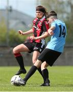 11 May 2019; Sean Cummins of Belvedere FC in action against Jessie Stapelton of Cherry Orchard during the U14 SFAI Cup Final match between Belvedere FC and Cherry Orchard at Oscar Traynor Centre in Dublin. Photo by Michael P. Ryan/Sportsfile