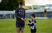 11 May 2019; Tipperary goalkeeper Evan Comerford signs an autograph for Tipperary supporter Ciarán Cassidy, aged 10, from Thurles, after the Munster GAA Football Senior Championship quarter-final match between Tipperary and Limerick at Semple Stadium in Thurles, Co. Tipperary. Photo by Diarmuid Greene/Sportsfile