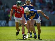 12 May 2019; Ed Connolly of Tipperary in action against Paul O'Riordan of Cork during the Electric Ireland Munster Minor Hurling Championship match between Cork and Tipperary at Pairc Ui Chaoimh in Cork. Photo by Diarmuid Greene/Sportsfile