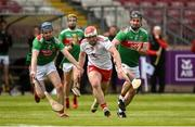 12 May 2019; Matthew Mulgrew of Tyrone in action against San Mulroy and Cathal Freeman of Mayo during the Nicky Rackard Cup Group 2 Round 1 match between Tyrone and Mayo at Healy Park, Omagh in Tyrone. Photo by Oliver McVeigh/Sportsfile