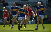 12 May 2019; Ed Connolly of Tipperary in action against Jack Cahalane of Cork during the Electric Ireland Munster Minor Hurling Championship match between Cork and Tipperary at Pairc Ui Chaoimh in Cork. Photo by Diarmuid Greene/Sportsfile